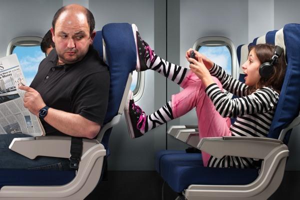 children kicking back of seat