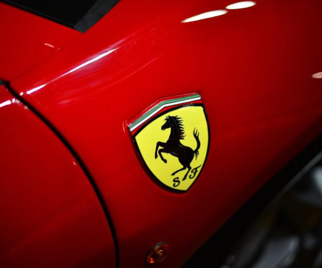Ferrari prancing horse yellow on red logo