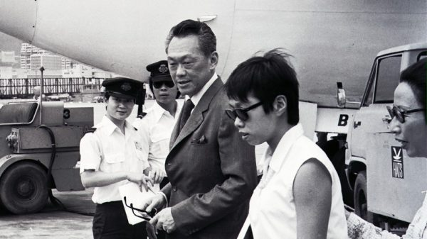 Mr. Lee Kuan Yew, rocking a 3 button suit jacket but expertly buttoning only the second one, accessorised with pocket square during a visit to Hong Kong.