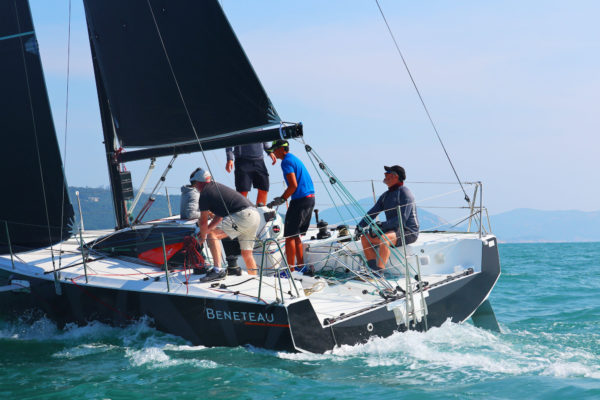 The author (pictured at the helm) was among the sailors able to sea trial the Figaro 3 during the yacht's brief Hong Kong stopover