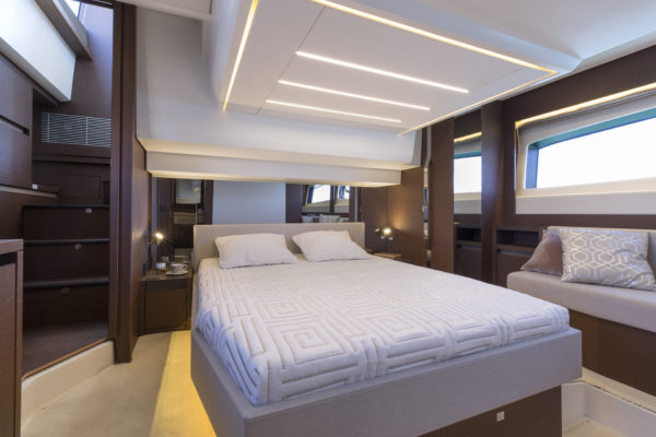 The full-beam master suite enjoys great light from both sides and even features a walk-in wardrobe; Photo © Jean-Marie LIOT / Prestige Yachts