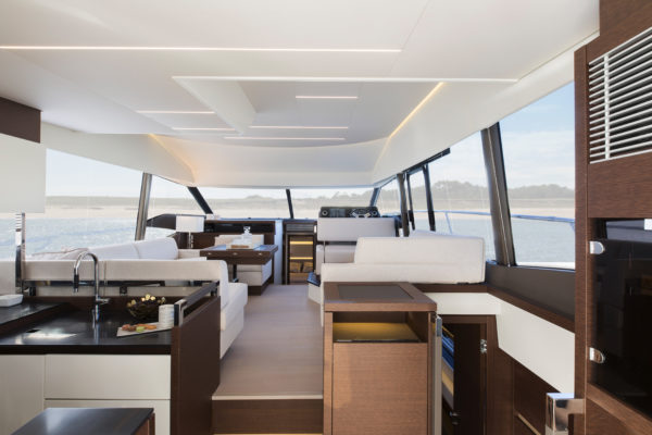 Compared to the saloon on the 500, Camillo Garroni has created larger windows and more space, shifting the owner's staircase aft; Photo: Jean-Marie LIOT / Prestige Yachts