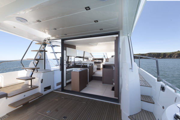 An improved cockpit layout leads into a split-level saloon with aft galley; Photo © Jean-Marie LIOT pour Prestige Yacht