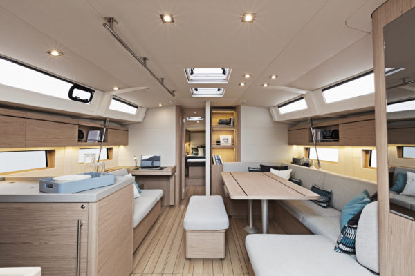 The spacious interior allows for an entire crew around the dinette, while natural light comes from an abundance of portlights and skylights
