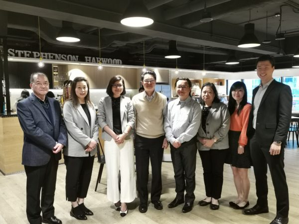 HKCYIA's Kara Yeung (third left) and Euroasia Dockyard management at the signing ceremony witnessed by lawyers of Stephenson Harwood