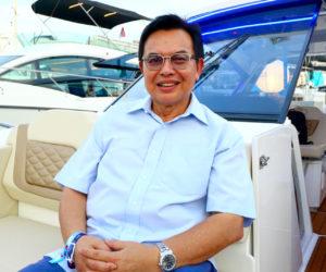 Tan Sri Dr Mohd Nadzmi Bin Mohd Salleh on his new Aquila 36 at the Singapore Yacht Show