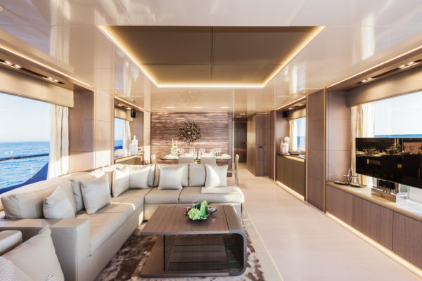 The saloon has large windows and a relatively conventional layout with a comfortable lounge and dining area