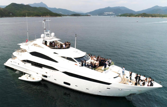 The Sunseeker 131 Yacht, here used for a wedding, is NextWave Charters' flagship