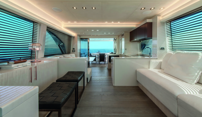 Benefiting from a light palette, the split-level saloon features the main lounge forward, while aft, one step down, is the dining area opposite the galley
