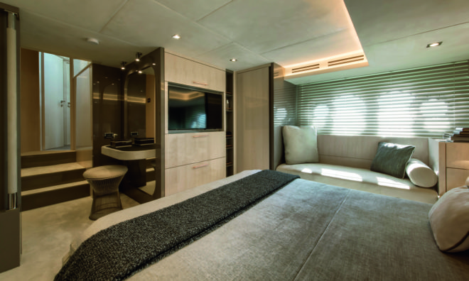 The superb full-beam owner's suite is midships, has storage and a sofa to the sides, and an elegant vanity table in the entrance hall