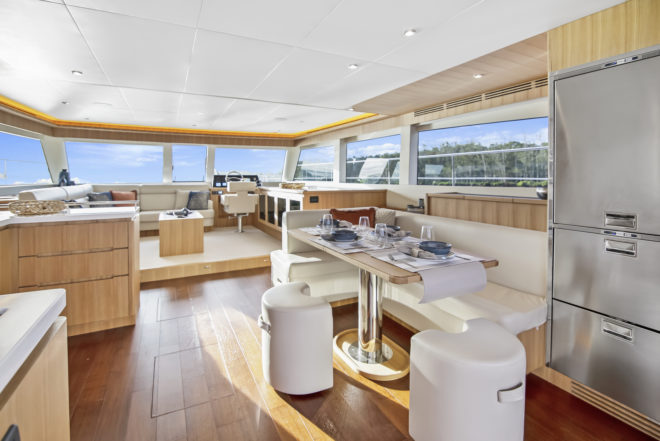 The ILIAD 50 features a large lounge forward of the galley and indoor dining areas