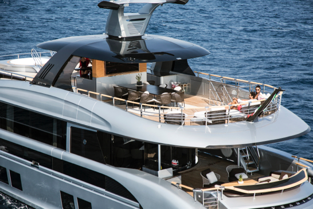 The sun deck has a dining table and loungers aft, while a sunbathing area and spa tub is forward