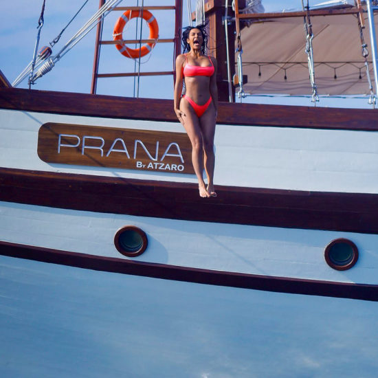 Kim Kardashian eventually jumps off the side of Prana by Atzaro, one of Asia's top charter yachts