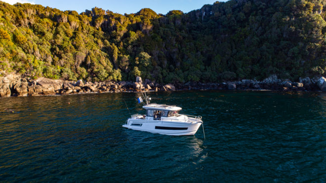 The Merry Fisher 895 Marlin anchors close inshore for protection