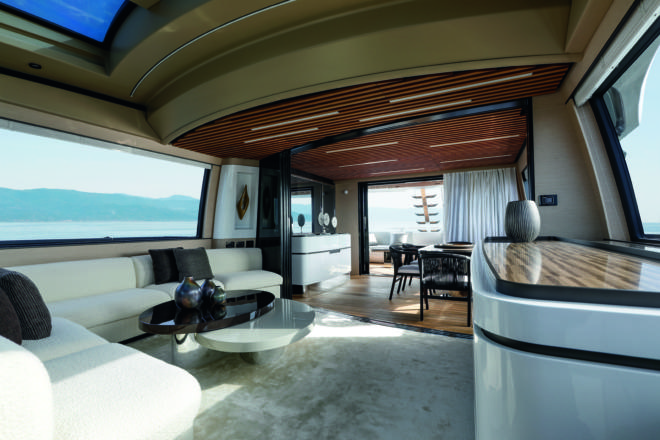 Azimut Grande S10: The main-deck interior features a dining area and a forward lounge area separated by curved doors, which open up to provide a large social area