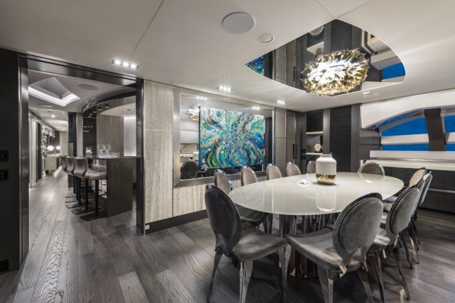 Pershing 140: Moving forward, the bar is followed by the dining room