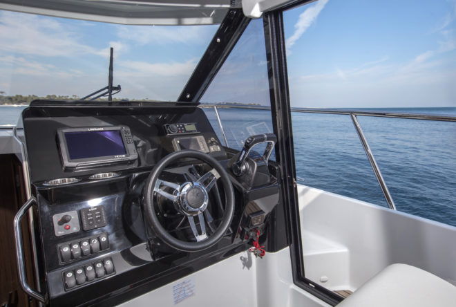 The Jeanneau Merry Fisher 1095's helm station has side deck access