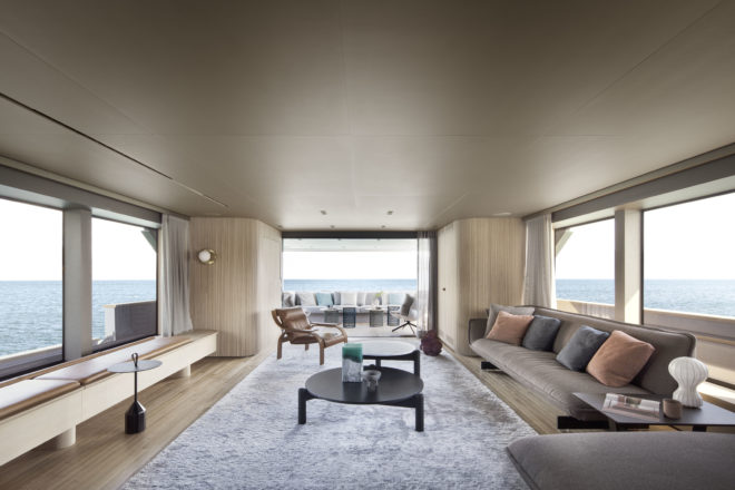 The vast main-deck saloon features huge windows and sofas designed by Patricia Urquiola for Cassina