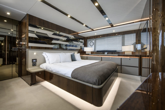 The impressive, full-beam master suite on a different Fairline Squadron 68 to the one shown on the previous interior photos, although both units feature gloss walnut woodwork