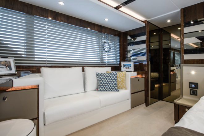 The master suite has a sofa to starboard, while the en-suite bathroom is aft of the bed and adjoins an impressive walk-in wardrobe