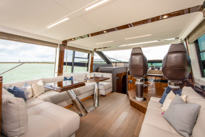 The Fairline Squadron 68 saloon has lots of seating on both sides and flexible table arrangements