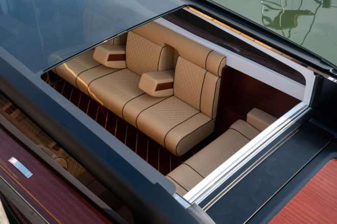 The luxury water taxi features a mix of wood and modern technology including hybrid power