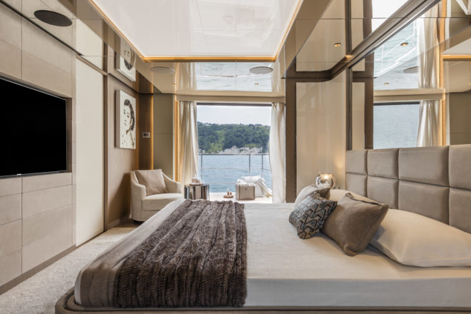 On hull one, the main-deck owner's suite features a drop-down balcony on the starboard side