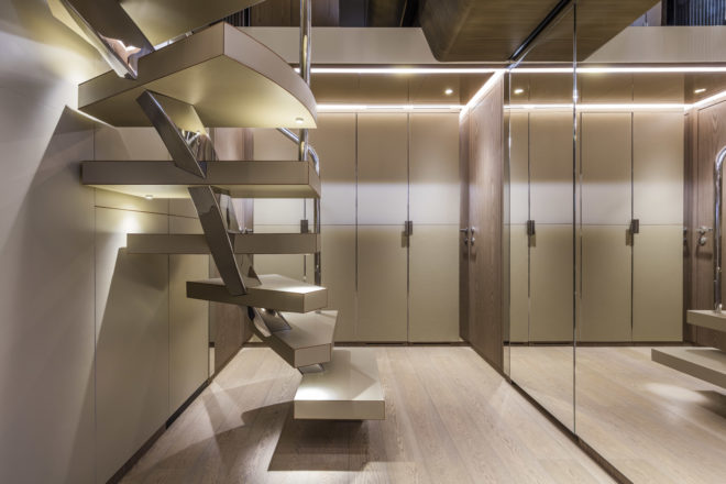 An elegantly designed staircase leads down to the lower-deck guest area