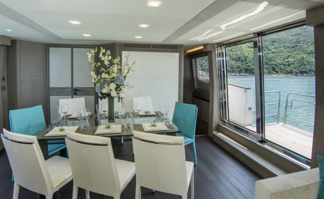 The dining area benefits from sliding doors and a drop-down balcony