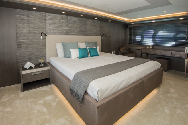 Accessed by a forward staircase, the full-beam master suite benefits from Monte Carlo Yachts' iconic overlapping-circle windows