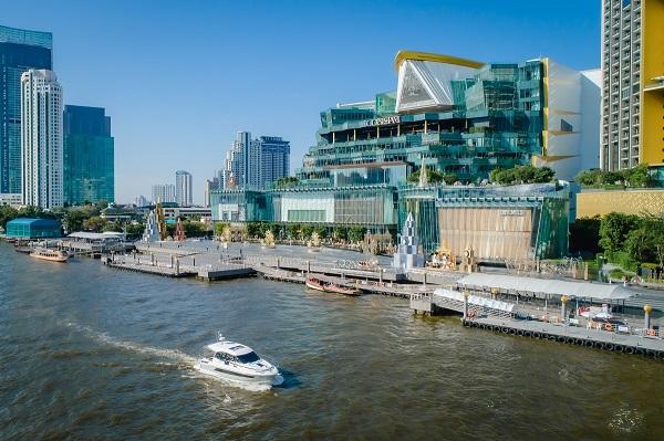 A Jeanneau NC33 cruises the Chao Phraya river in Bangkok