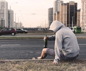 man on the streets with bottle