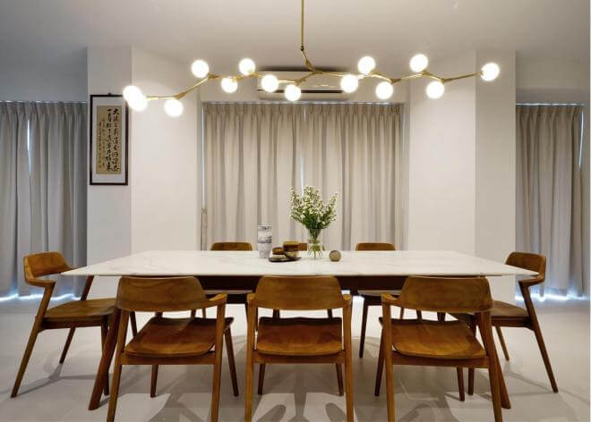 Wooden furniture adds warmth to this dining space.